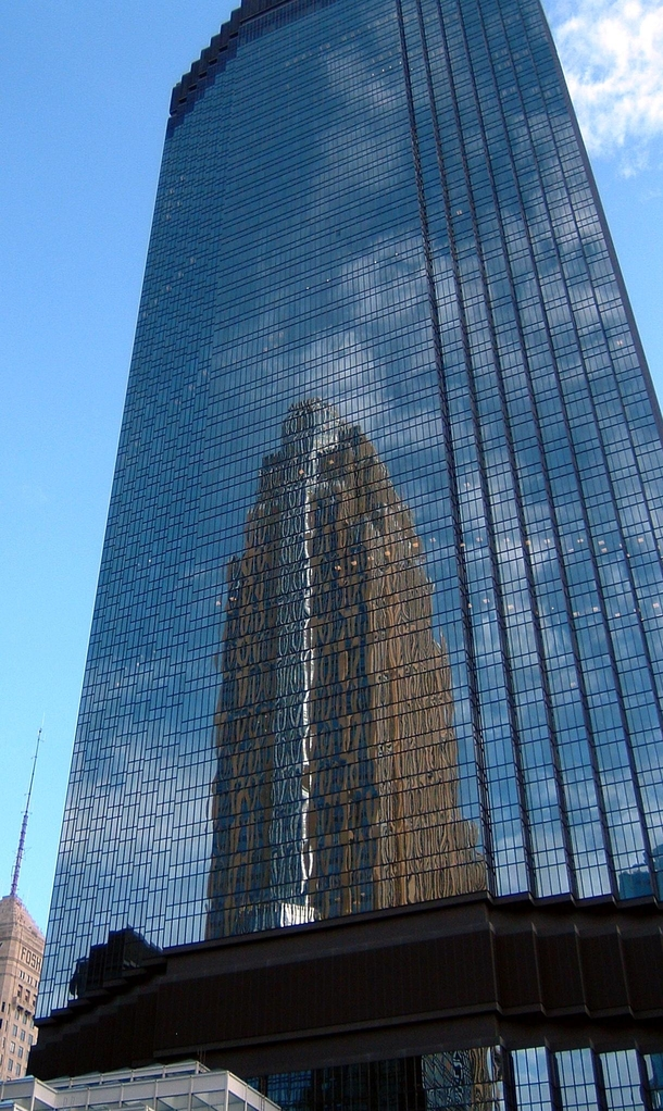 IDS Center by Philip Johnson  reflecting the Wells Fargo Center by Csar Pelli  Minneapolis MN