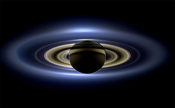 In a natural color mosaic Saturn eclipses the Sun as seen by NASAs Cassini spacecraft on July   Earth is barely visible as a single pixel just below the main rings and to the right of the planet