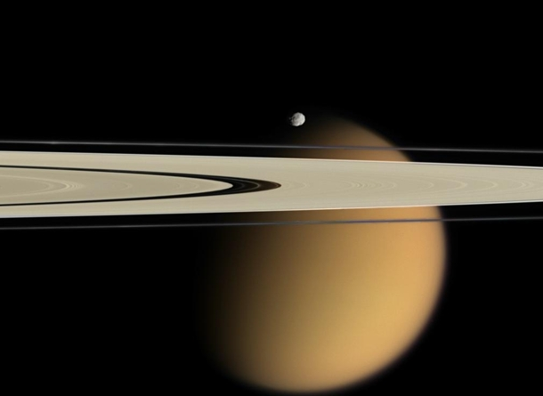 In  April Cassini captured Saturns A and F rings stretching in front of cloud-shrouded Titan Near the rings and appearing just above Titan was Epimetheus a moon which orbits just outside the F ring