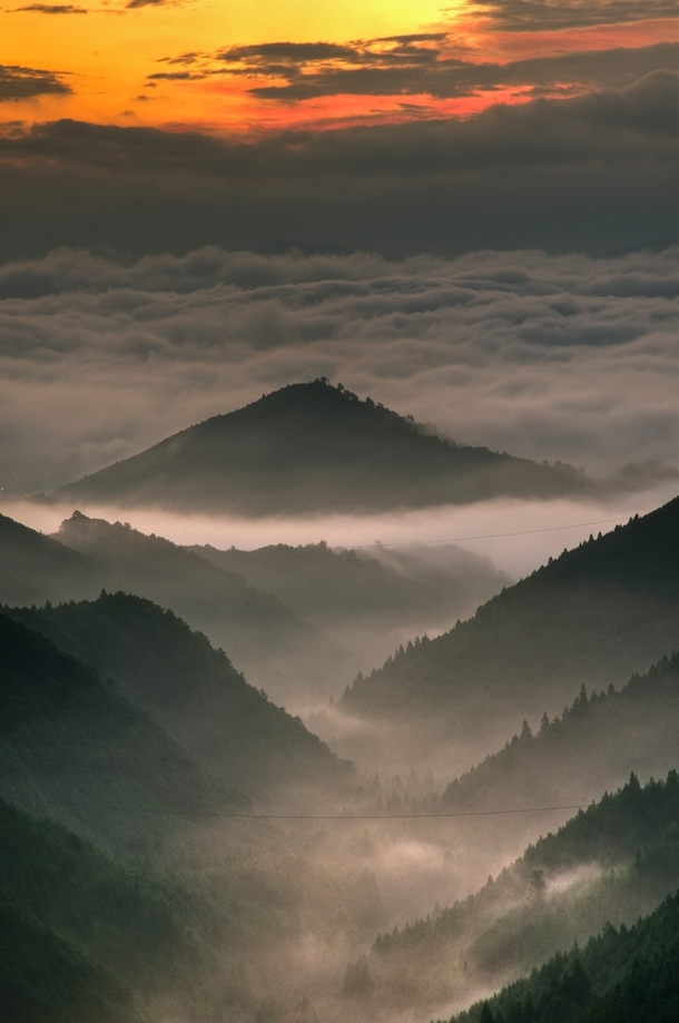 Kumano clouds hovering above the Wakayama Prefecture in Japan Photo by Masahisa