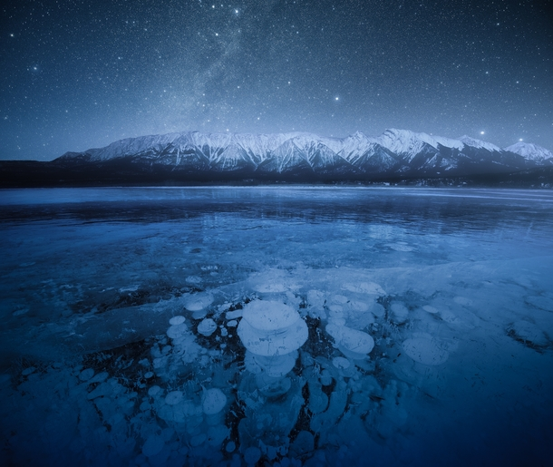 Last winter I went camping at a frozen lake in the Rocky Mountains This is why Abraham Lake AB