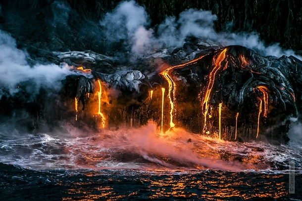 Lava from the Kilauea volcano flowing into the ocean Taken in Hawaii by Alexandre Socci xpost rLavaPorn