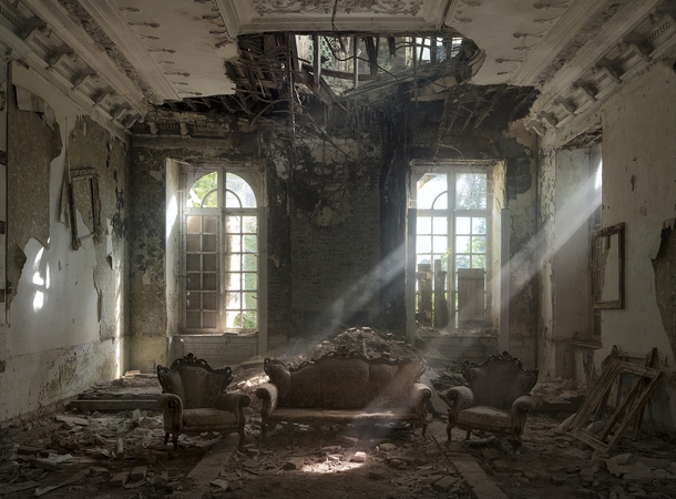 Light beams pick out dust suspended in the air at a chateau in Belgium by