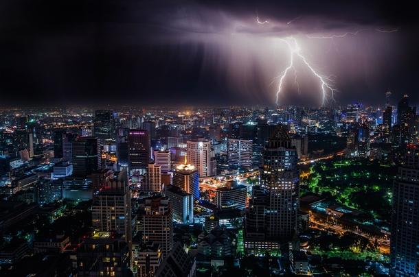 Lighting storm at night over Bangkok Thailand Photo credit to Dominik Qn