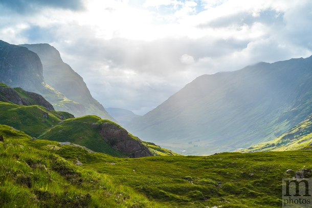 Looking down Glen Coe Scotland after an overcast day The clouds parted for a moment and got some spectacular light