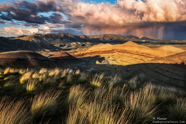 Me and my buddy had the pleasure of watching a sunset light up a rain storm in The Painted Hills OR