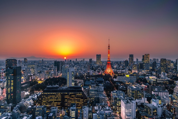 Metropolis - A sunset over Tokyo with Mt Fuji in the distance by