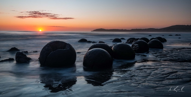 Moeraki Boulder Sunrise New Zealand  Only had one morning to spare for this spot but New Zealand didnt disappoint