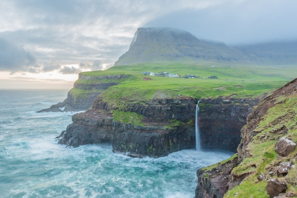 Mulafossur Waterfall as a storm approaches Faroe Islands