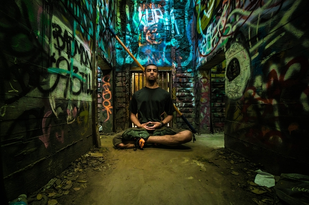My friend meditating in the cages of the abandoned LA zoo