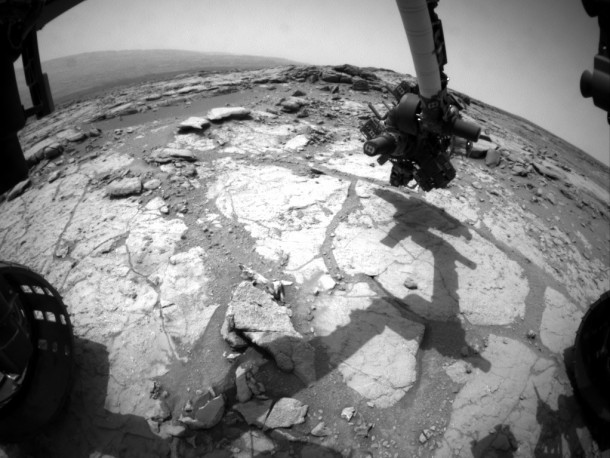 NASAs Mars rover Curiosity used its front left Hazard-Avoidance Camera for this image of the rovers arm over the drilling target Cumberland during the th Martian day or sol of the rovers work on Mars May