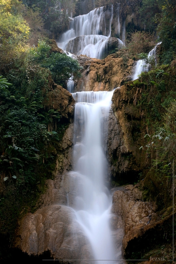 Part of the m tall travertine cascades of Kuang Si waterfall Luang Prabang Laos