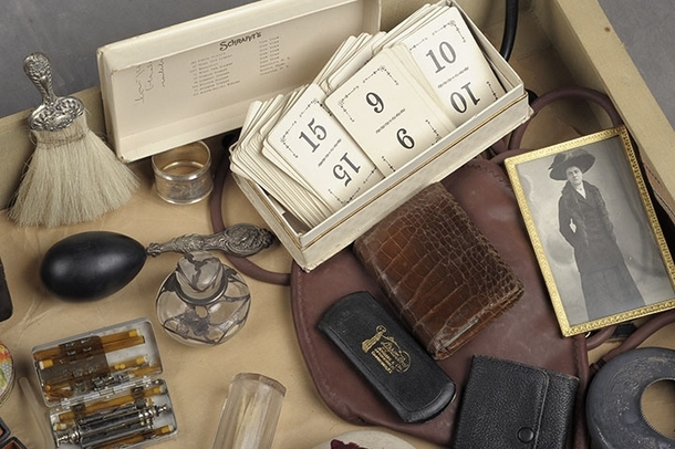 Pics of a trunk left in a NY insane asylum of patient Flora T Who was locked away for the rest of her life In her possessions a perfume bottle and silver napkin ring reveal a woman of class However the kit of needles and injection drugs add a dark element