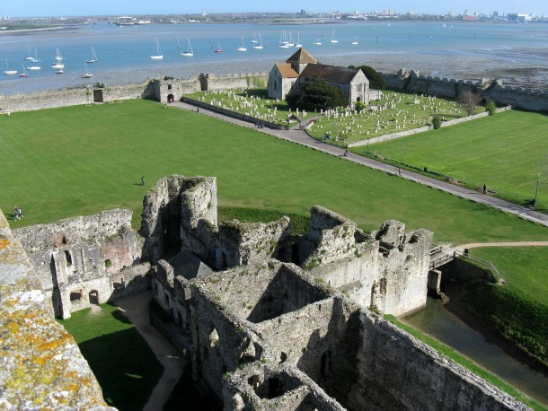 Portchester Castle UKView of the outer bailey from the medieval keep showing the Norman church Saxon gate and Roman walls