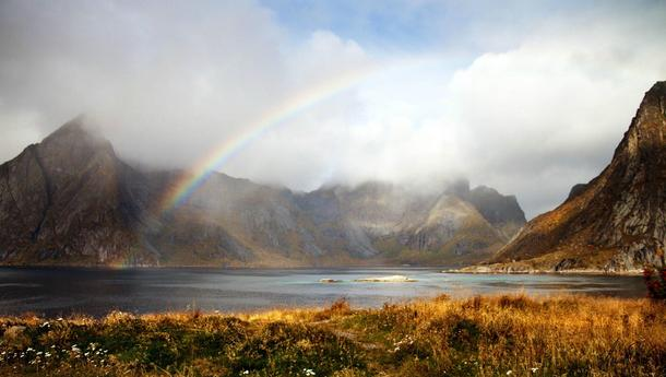 Rainbow breaking the clouds Lofoten Norway