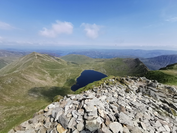 Red Tarn and Striding Edge from Hellvelyn with Ullswater in the background Lake District UK