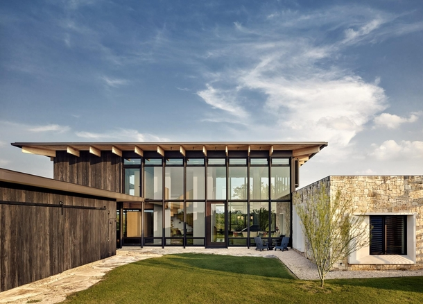 Residence on a remote stretch of the Llano River with locally sourced limestone douglas fir structural wood and shou sugi ban siding Mason Texas by Michael Hsu Office of Architecture Photo Casey Dunn