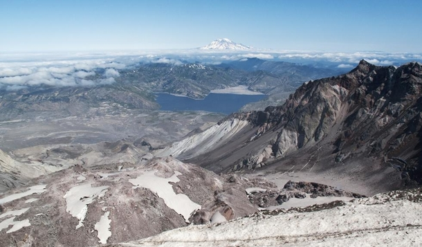 Rim of Mt St Helens lava dome in foreground-left Spirit Lake with yo log jam mid-ground and Mt Rainier in background  by clive_dexx