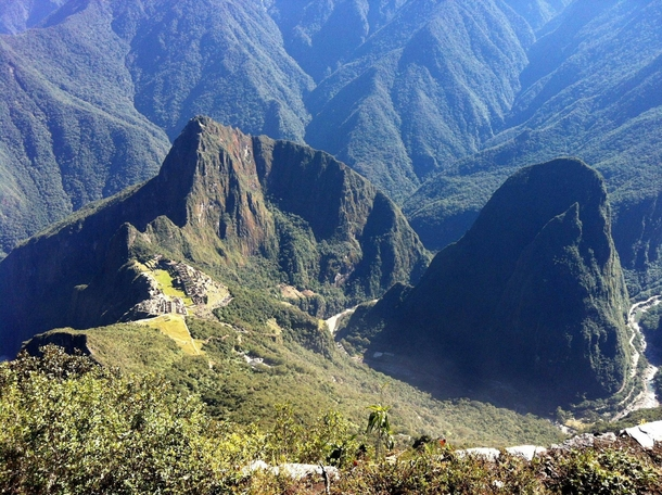 Ruins of Machu Picchu and surrounding mountains as seen from the mountain of Machu Picchu