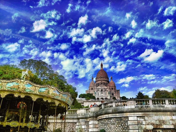 Sacre Coeur Basilica in Paris  The relaxed side of Paris with people having picnic in the lawn drinking wine and playing games