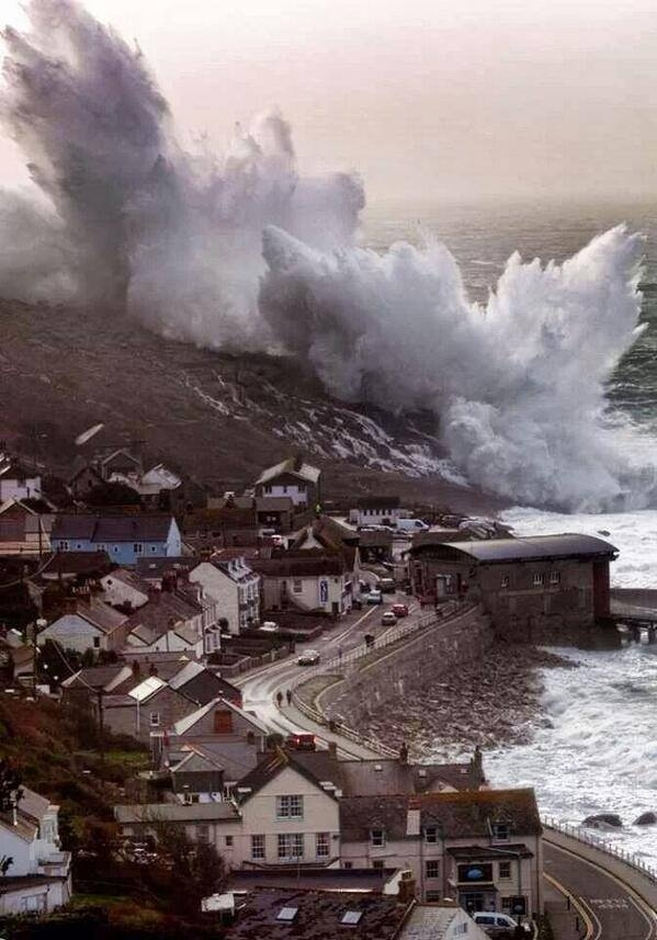 Sea crashing against the cliffs at Sennen Cove in Cornwall UK