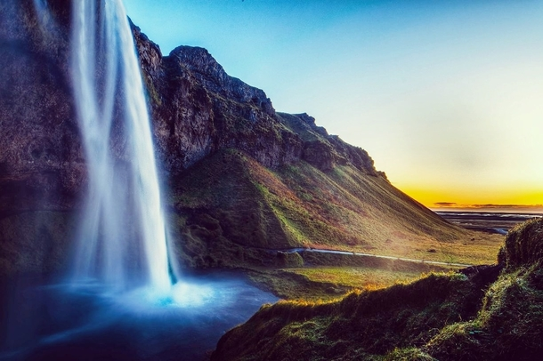 Seljalandsfoss Waterfall just before sunset My boyfriend photographer and I spent  days road tripping around Iceland   IG divingdrifters