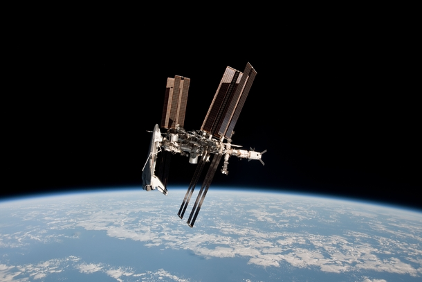 Shuttle docked with ISS and Earth in the background