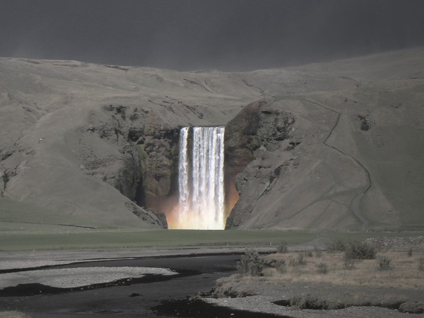 Skgafoss waterfall during the last Eyjafjll volcanic eruption