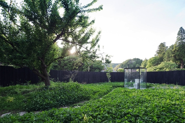 Sou Fujimotos public toilet in Ichihara is a garden escape the glass box lavatory sits in the middle of a  sqm garden enclosed by a  meter wooden log roll fence to maintain privacy