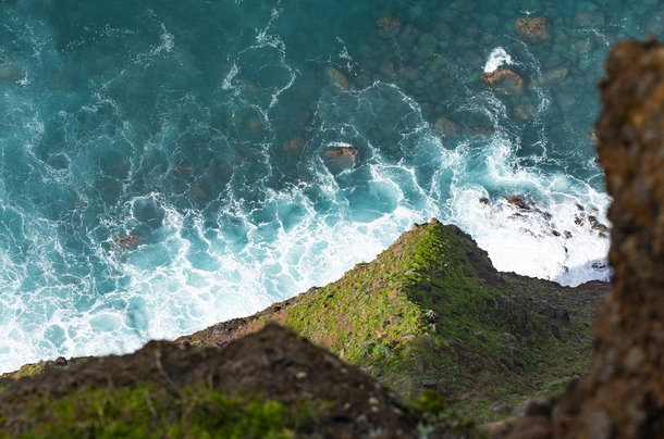 Steep cliff and turquoise water in Madeira