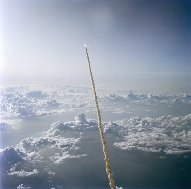 STS- on its way through the clouds with the first American woman ever in space aboard   x
