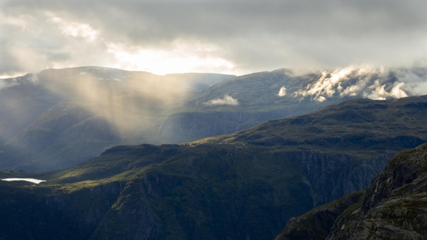 Sun breaking through the clouds Osa Hardanger Western Norway