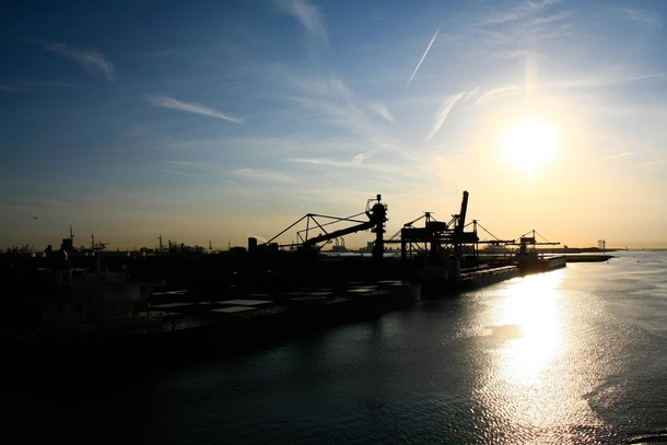 Sunrise over the industrial harbour Rotterdam Netherlands