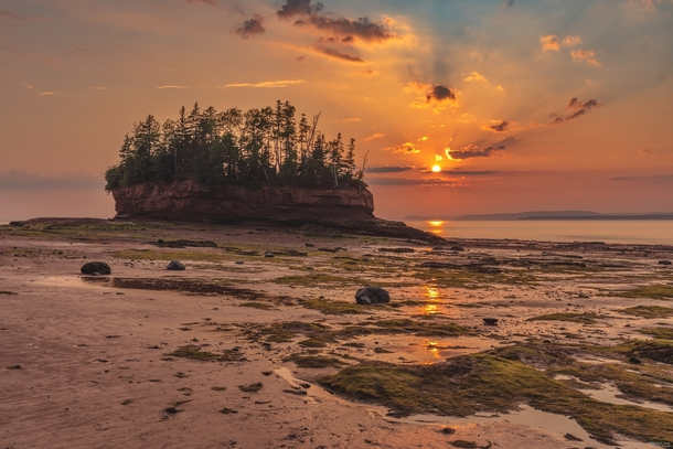 Sunset while standing on the seafloor during low tide at Burntcoat Park Nova Scotia