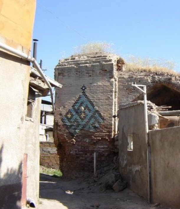 The Abbas Mirza mosque in Yerevan Armenia was one of dozens of th and th century mosques razed or left derelict during the Soviet period Only part of its outer wall remains hidden behind newer houses