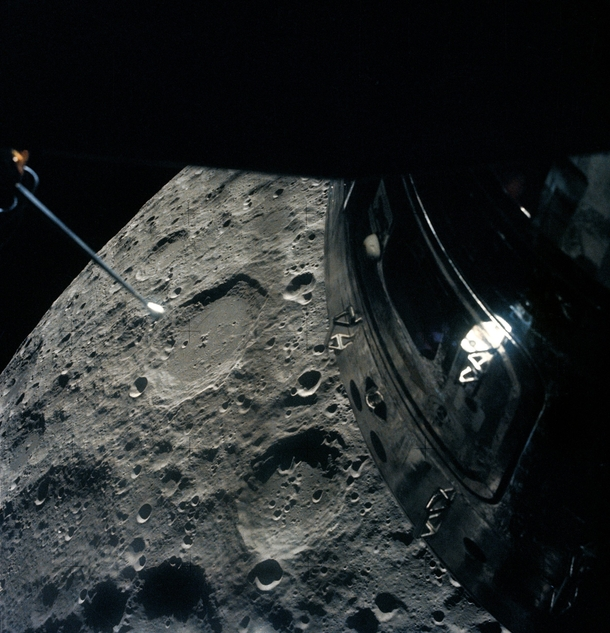 The Apollo  crew photographed the Moon out of the Lunar Module overhead rendezvous window as they passed by the deactivated Command Module is visible