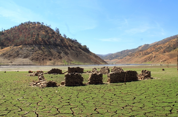 The California drought has drained Pine Flat Reservoir exposing a structure from the the turn of the th century that has been under water for  years Story and album in comments