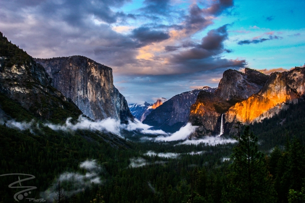 The clouds were rolling in the sun was setting a fiery glow to the rocks Yosemite valley CA