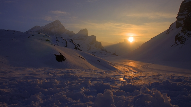 The first light of day reflected off of the snow in Leukerbad Switzerland -