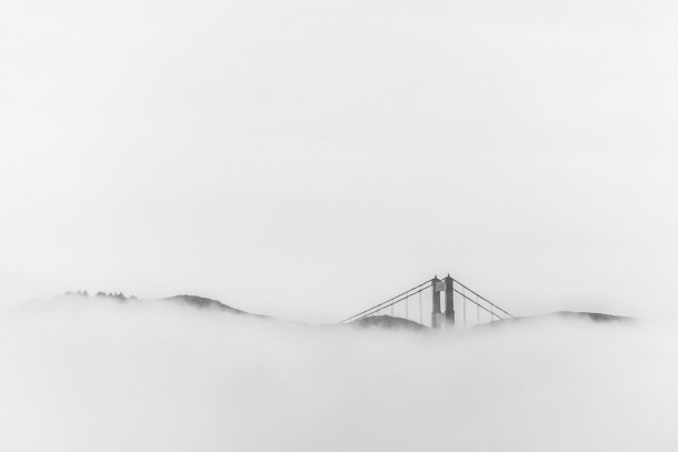 The fog rolled in over the Golden Gate Bridge while I was hanging out in Fishermans Wharf