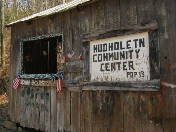 The ghost town of Mudhole TN has a community center that is decorated for every season Largely abandoned during the Great Depression by people searching for job opportunities less than  people remain It had a post office schoolshown here churches and gene