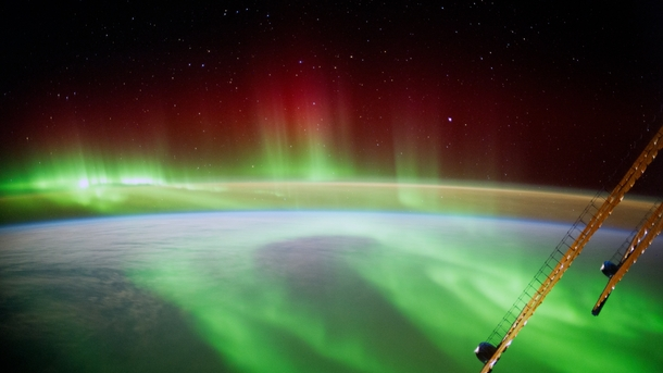 The ISS floating above the Aurora Borealis  by Alexander Gerst ESA astronaut