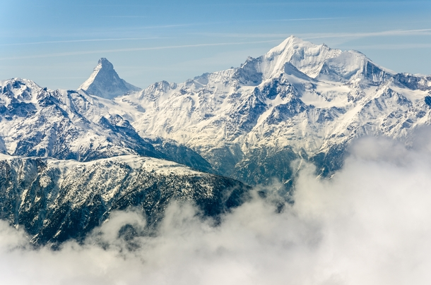 The Matterhorn and Weisshorn rising above the clouds - Valais Switzerland