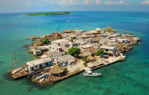 The most densely populated island on the planet where more than  people inhabit less than three acres of land Santa Cruz del Isolte Columbia