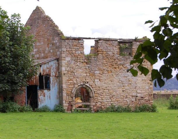 The remains of a th century building Adlingfleet Medieval Rectory with re-used th c arch collapsing in the East Riding of Yorkshire Lots more in comments xpost from MedievalPorn