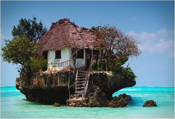 The Rock Restaurant in Zanzibar Tanzania can be reached both on foot and by boat depending on the tide