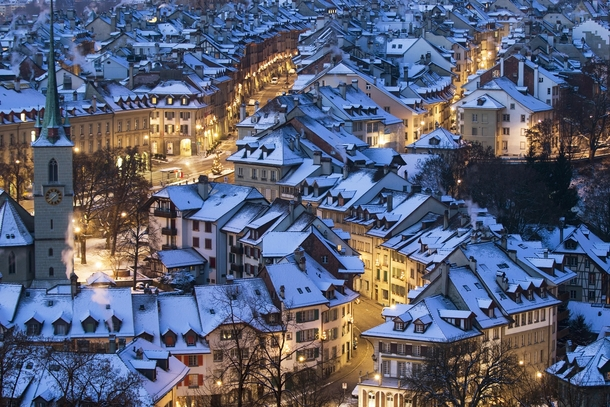 The snow-covered roofs of Bern Switzerland  xpost from rSchweiz
