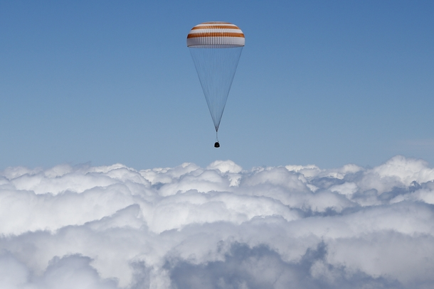 The Soyuz TMA-M capsule carrying NASAs Tim Kopra Tim Peake of the European Space Agency and Russian agency Roscosmos Yuri Malenchenko descends beneath a parachute near the town of Dzhezkazgan Kazakhstan Saturday June   Photo credit Shamil ZhumatovPool Pho