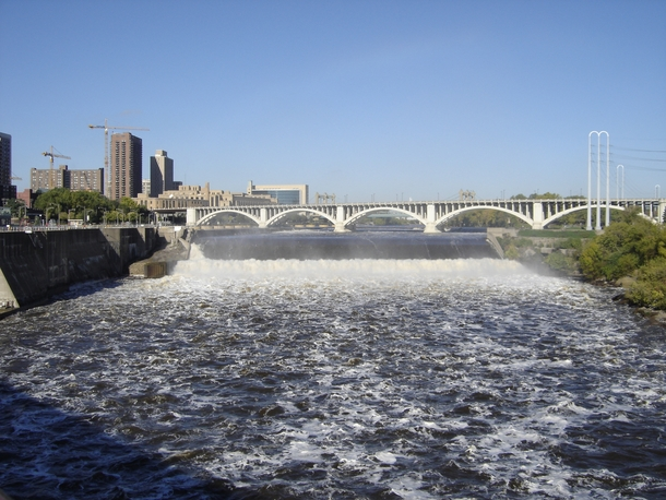 The Third Avenue Bridge over the Mississippi in Minneapolis with the upper Saint Anthony Falls dam and lock in the foreground
