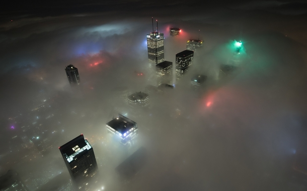 The Toronto skyline submerged in fog